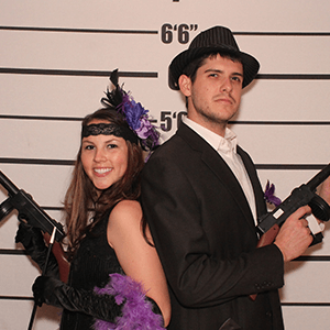 New York Murder Mystery party guests pose for mugshots